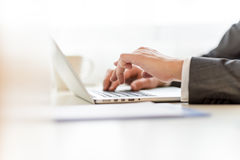 Composing legal document on laptop computer. Closeup of lawyers hands typing legal document on laptop computer Royalty Free Stock Photos