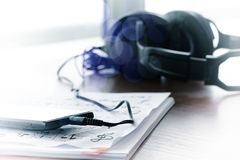 Composing music concept with shallow DOF evenly matched jack of. Headphone and copy space Stock Photography
