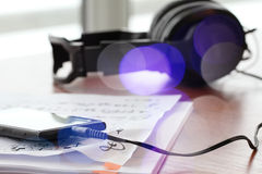 Composing music concept. With shallow DOF evenly matched jack of headphone and copy space royalty free stock photography