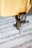 Composing music mechanically with a sewing machine Royalty Free Stock Photos