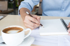 Composing music note  top view with hand writing coffee and blue Stock Photos