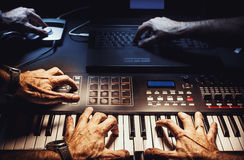 Composing Music Nowadays. Conceptual composition about composing and songwriting nowadays, details of a small home studio royalty free stock photography