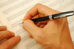 Composing music on old manuscript. For concepts like music composition, and ideas and creativity Stock Photos