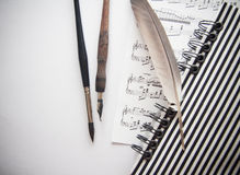 Composing and writing notes; background with copy space Royalty Free Stock Images
