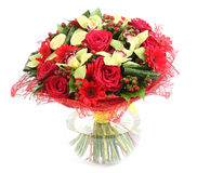 Composição floral no vidro, vaso transparente: rosas vermelhas, orquídea Imagem de Stock Royalty Free