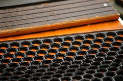 Non-slip black matting. Composite black rubber non-slip matting on orange painted gangway Royalty Free Stock Photo
