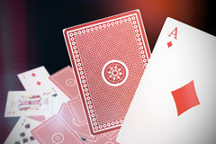 Composite 3d image of ace of diamonds card. Ace of diamonds 3D card against dark grey background Stock Photos