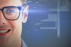 Composite 3d image of close up of smiling young man wearing eyeglasses. 3D image of close up of smiling young man wearing eyeglasses against dark grey background Royalty Free Stock Photography