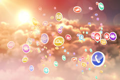 Composite 3d image of colourful computer applications. Against scenic view of bright orange sun over clouds during sunset royalty free illustration