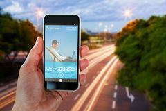 Composite 3d image of cropped hand holding smart phone stock photo