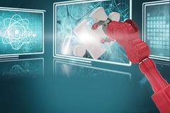 Composite 3d image of cropped of red robotic hand holding puzzle piece. Cropped of 3D red robotic hand holding puzzle piece against composite image of different Royalty Free Stock Photography