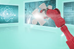 Composite 3d image of cropped of red robotic hand holding puzzle piece. Cropped of 3D red robotic hand holding puzzle piece against composite image of different Stock Photos
