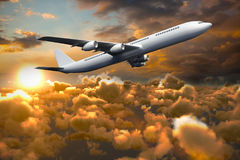 Composite 3d image of graphic airplane. Against blue and orange sky with clouds stock illustration