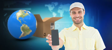 Composite 3d image of handsome delivery man showing mobile phone. Handsome delivery man showing 3D mobile phone against illustration of various diagrams and Stock Photo