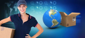 Composite 3d image of happy delivery woman holding cardboard box. Happy delivery woman holding cardboard box against digitally composite 3D image of various Stock Photography