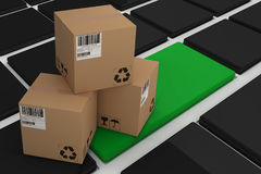 Composite 3d image of high angle view of brown cardboard boxes. High angle view of brown cardboard 3D boxes against black keyboard with green key Stock Photo