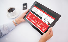 Composite 3d image of man using tablet pc. Man using 3D tablet pc against digital composite image of e-learning interface on screen Royalty Free Stock Photography