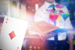 Composite 3d image of midsection of bartender serving cocktail and martini. Against ace of diamonds card stock photography