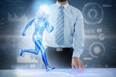 Composite 3d image of midsection of businessman touching invisible screen at desk Stock Images