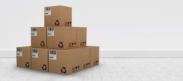 Composite 3d image of pile of brown packed cardboard boxes. Pile of brown packed cardboard 3D boxes against gray flooring and wall Royalty Free Stock Image