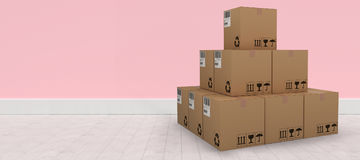 Composite 3d image of pile of packed cardboard boxes. Pile of packed cardboard 3D boxes against pink wall by hardwood floor Royalty Free Stock Photography