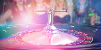 Composite 3d image of smiling friends having hen party. Smiling friends having hen party against close up image of 3d roulette wheel Stock Image