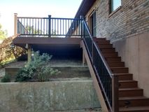 Composite deck with pecan decking and mocha railing Stock Photos