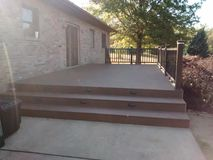 Composite deck with pecan decking and mocha railing Royalty Free Stock Photos