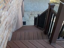 Composite deck with pecan decking and mocha railing Royalty Free Stock Image