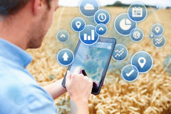 Composite Of Farmer In Field Accessing Data On Digital Tablet Royalty Free Stock Image
