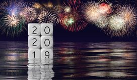 Composite of fireworks and calendar for 2020 New Year holiday background royalty free stock photography