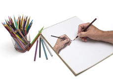 Composite Hand Drawing. Composite drawing of an artist illustration of his own hand using colored pencils Stock Images