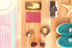 Composite image of accessories and travel items on wooden board Royalty Free Stock Photography