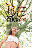 Composite image of active happy brunette smiling at camera Stock Images