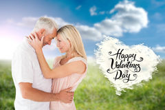 Composite image of affectionate couple standing and hugging Stock Image