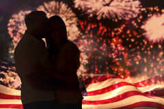 Composite image of affectionate man kissing his wife on the cheek Stock Photography