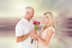 Composite image of affectionate man offering his partner roses Royalty Free Stock Photography
