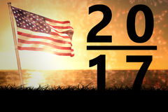 Composite image of 2017. 2017 against composite image of american flag with firework stock illustration