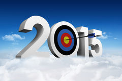 Composite image of 2015. 2015 against bright blue sky over clouds Stock Photography