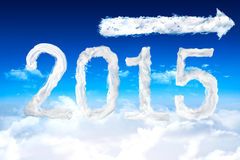 Composite image of 2015. 2015 against cloud arrow Royalty Free Stock Photo