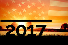 Composite image of 2017. 2017 against panoramic view of american flag Stock Image