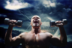 Composite image of aggressive bodybuilder lifting bumbbells Stock Photography