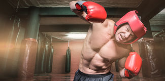 Composite image of aggressive boxer against black background Royalty Free Stock Image