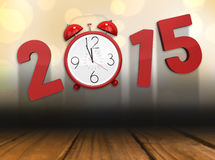 Composite image of 2015 with alarm clock. 2015 with alarm clock against shimmering light design over boards Stock Images