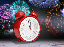 Composite image of alarm clock counting down to twelve Stock Image