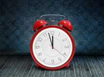 Composite image of alarm clock counting down to twelve Stock Images