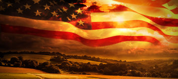 Composite image of american flag waving on pole Royalty Free Stock Image