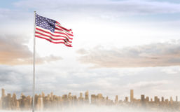 Composite image of american flag waving on pole Stock Images