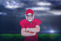 Composite image of american football player with arms crossed Stock Photo