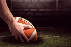 Composite image of american football player preparing for a drop kick 3D Stock Photos